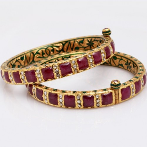 A Pair of Gold Enamel Bangle in Ruby & Chakri Diamonds.